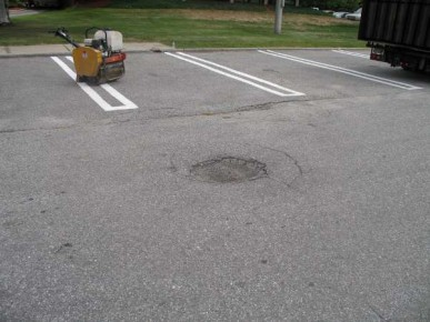 Demonstration of pothole repair in parking lot of fast food restaurant.  The hole was approximately 2ft by 2ft and the total repair area approximately 4ft by 4ft.