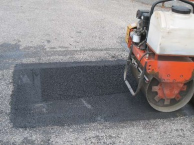 The rest of the area is smoothed to an even surface with the vibrating roller.