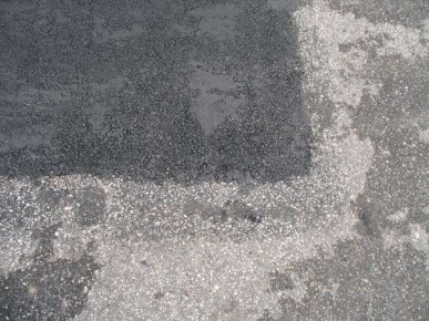 Notice how the new asphalt bonds with the existing asphalt.  This seamless repair does not allow water to enter repair area - unlike traditional cut and saw repair methods.